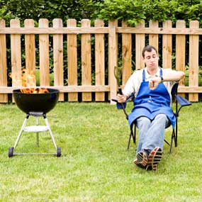 Man waiting for grilled food to cook.