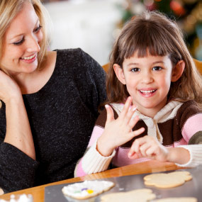 Little girl and mom baking cookies