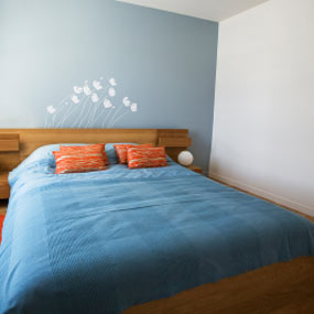 Tranquil room with blue paint on the walls.