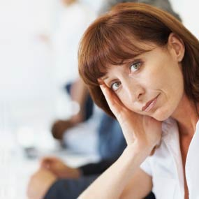 A women looks bored during a meeting
