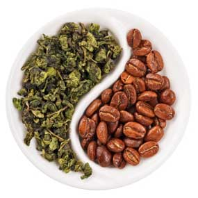 Coffee beans and dried green tea leaves.