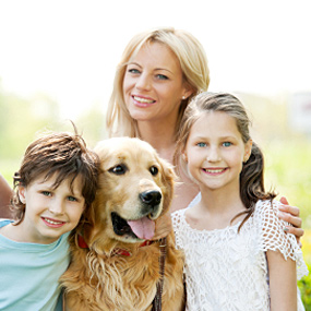 A family poses with their dog