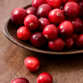 Cranberries spill out of a bowl