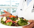 doctor holding a plate of vegetables