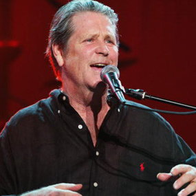 Former Beach Boy Brian Wilson sings at a live performance