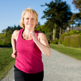A woman jogging outdoors.