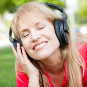 A woman listening to music on her headphones.