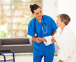 caregiver assisting parkinson's patient