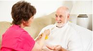 caregiver taking care of patient with moderate to severe atrial fibrillation
