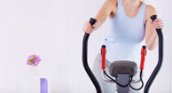 woman exercising on elliptical
