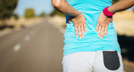 runner experiencing lower back spasms