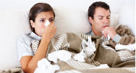 woman and man in bed with the flu