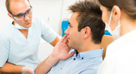 man telling dentist about bruxism