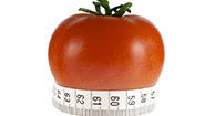 measuring tape wrapped around tomato