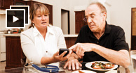 man and woman checking blood sugar levels
