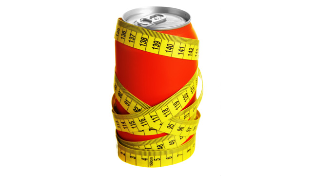 measuring tape wrapped around soda can