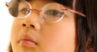 Girl wearing glasses for Nearsightedness