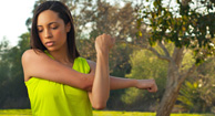 woman stretching her shoulder muscles