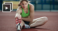 runner stretching her hamstring muscle