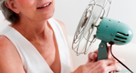 woman fanning herself during menopause