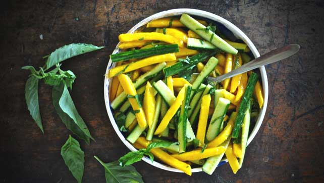 Mango cucumber salad with cayenne dressing and lime basil