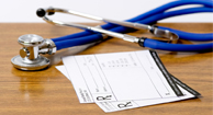 stethoscope with medical notepads