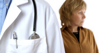 doctors jacket with stethoscope and worried woman