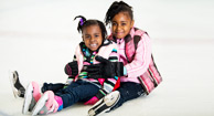 young girls ice skating