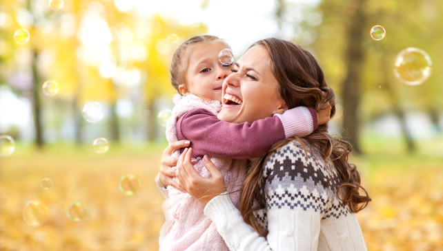 Mother happy outdoors with daughter
