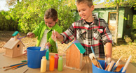 kids painting bird houses