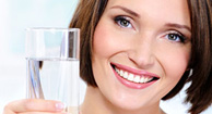 woman with oab holding a glass of water