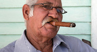 elderly man smoking a cigar