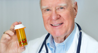 doctor holding pill bottle