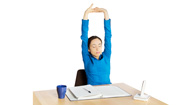 woman doing shoulder stretches at her desk
