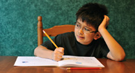 boy with adhd doing his homework