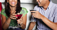 man and woman drinking cocktails