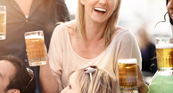 woman drinking beer with friends
