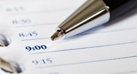 A pen and calendar