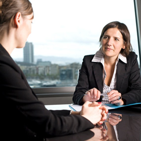 A woman conducting a job interview