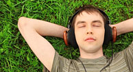 A man listens to music to relax