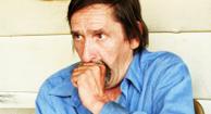 aging man coughing