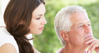 A woman talking to her father about COPD.