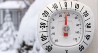outdoor thermometer in snowy weather