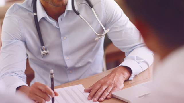 doctor explaining biologics to patient