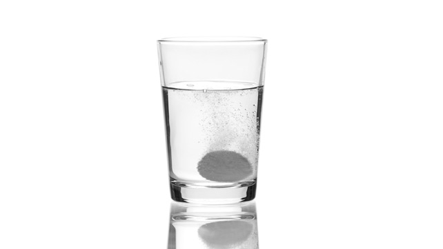antacid in water glass
