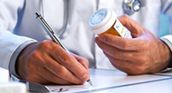 doctor writing hepatitis c prescription