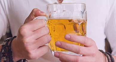 man with hepatitis c drinking beer