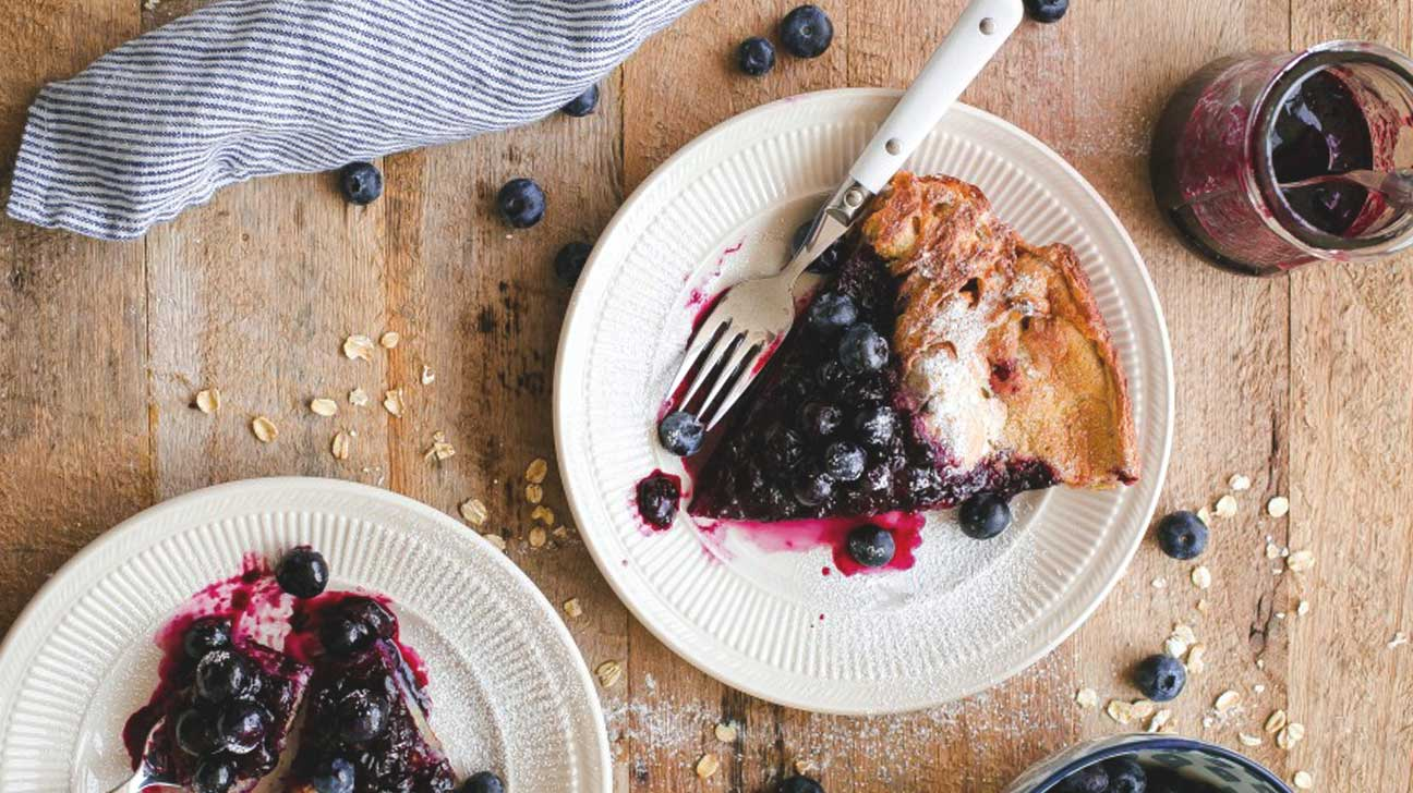 Gluten-free Dutch baby with blueberry maple syrup