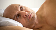 man with low t lying in bed