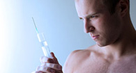 man holding a needle with testosterone cypionate